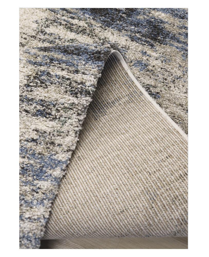 Imagen de detalle de la Alfombra Blur azul y gris