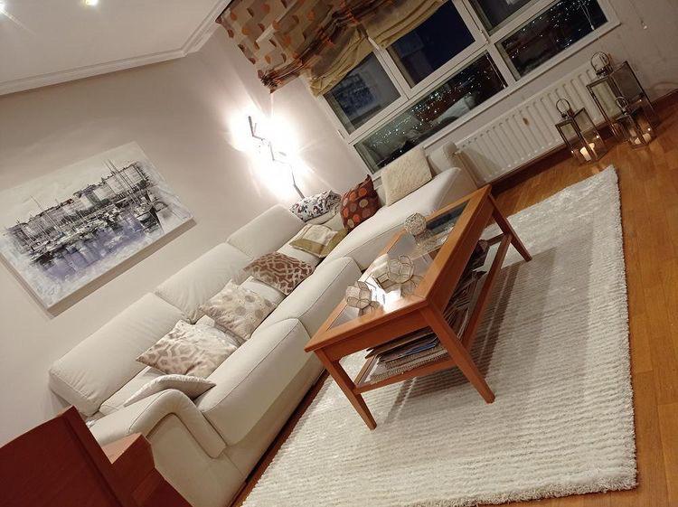 Imagen de una alfombra con un mantenimiento perfecto, en un salón